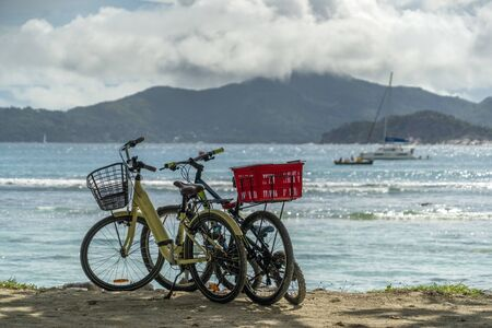 bicycles on the paradise lagoon vacation la digue island seychelles background