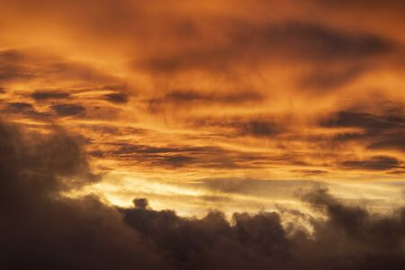 gold sunset cloudy sky background in seychelles
