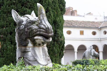 giant animal statue in Bath of Diocletian in Rome Michelangelo cloister Stock Photo