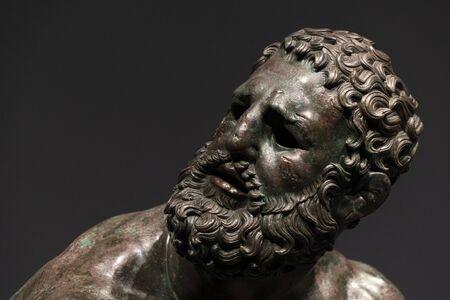 Boxer pugilist greek bronze statue in Rome