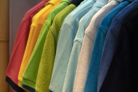 different colors polo shirt on display stand Imagens