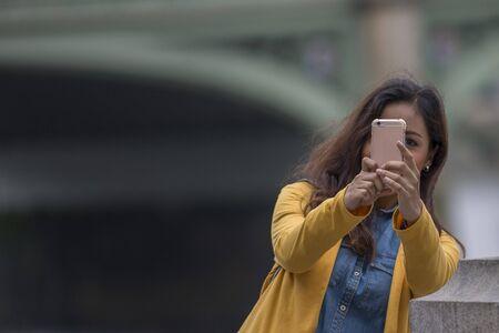 beautiful black hair caucasian latina girl taking a selfie