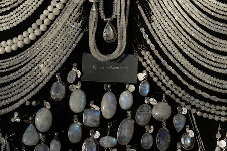 Rainbow moonstone necklage earrings jewelry on display stand in a shop market detail