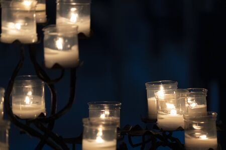 votive candles inside a church isolated on black background