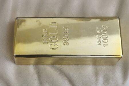 Gold ingot isolated close up