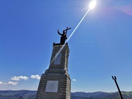 Christ statue on Giarolo Mountain top Italy