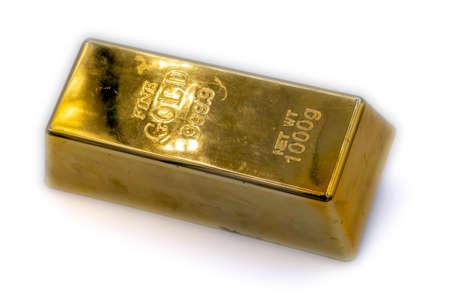 Gold ingot isolated on white background close up