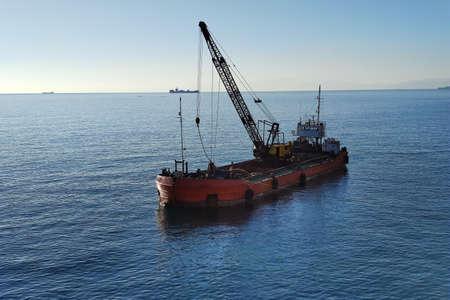 Dredge varge ship while dredging