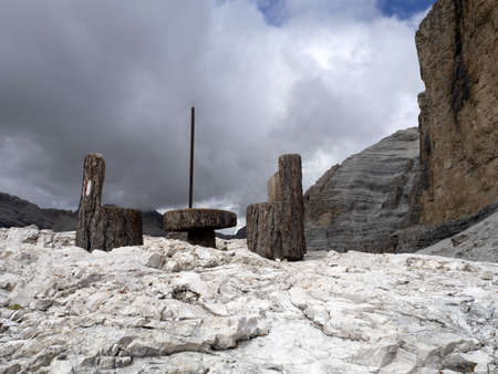 table and chairs on top of tofane dolomites mountains panorama landscape