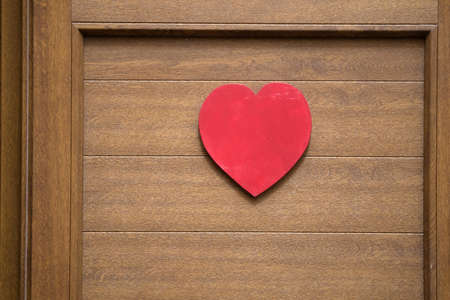 wooden closed door with love red hearth