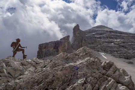 alpinist silhouette in tofane dolomites mountains panorama landscape