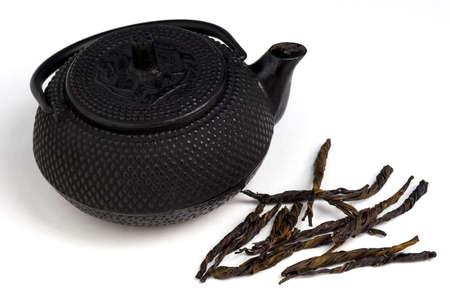 Tea pot and tea leaves