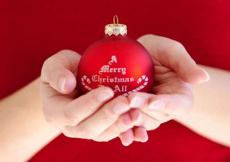 Woman holding christmas ball