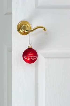 Christmas coming  Red christmas ball on the door