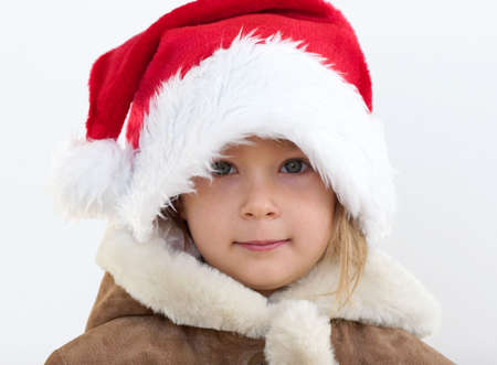 Snow Maiden  Little pretty girl with santas hat Stock Photo