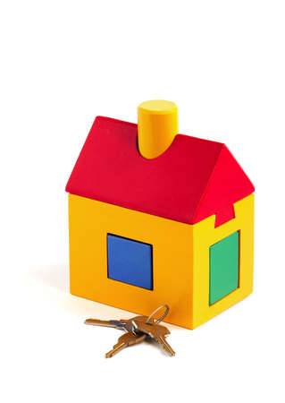 Toy house and keys over white background Stock Photo