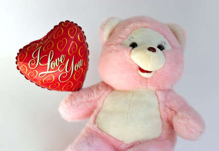 loveheart: Teddy bear with heart balloon Stock Photo