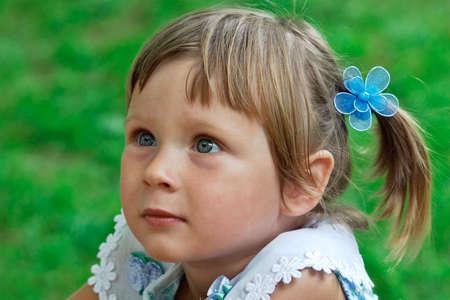 Portrait of little girl listening some story Standard-Bild