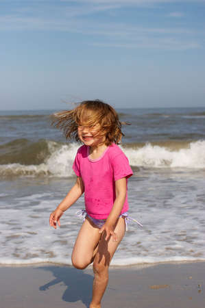 simple girl: Little girl at the beach Stock Photo