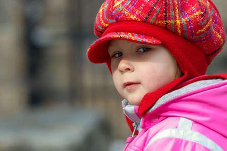 Little girl in a fancy red hat photo