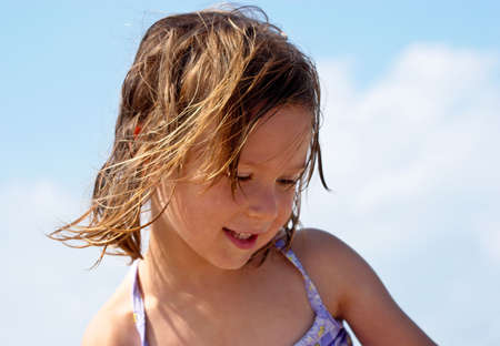 Little girl at the beach Stock Photo