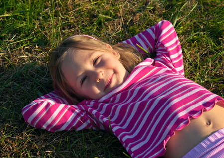 Happy girl laying on a grass Stock Photo - 332628