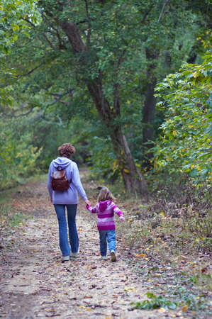 Mom with her daughter hiking
