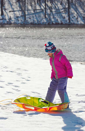 toboggan: Little girl with toboggan Stock Photo