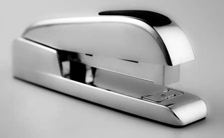 office stapler: Stainless steal stappler Stock Photo