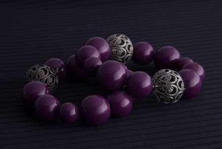 silver jewelry: purple and silver bracelets Stock Photo