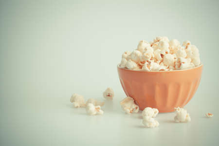 Orang popcorn bowl on a white background photo