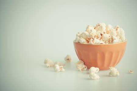 orang: Orang popcorn bowl on a white background Stock Photo