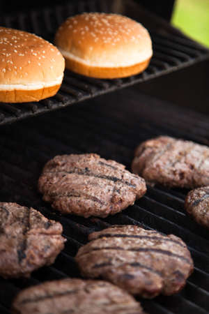 Hamburgers cooking on the BBQ grill