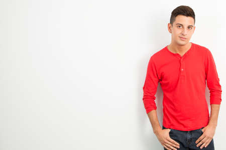 Young man against white background