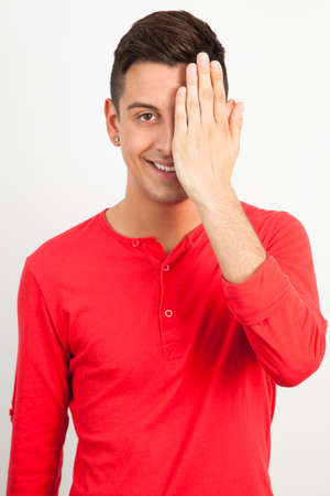 Young and handsome guy posing over white background Banco de Imagens