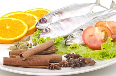 Fresh fish decorated on cream plates Stock Photo - 11062409