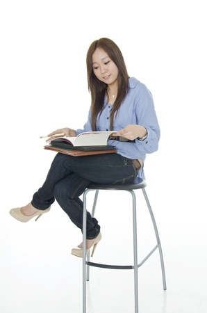chinesse: Chinesse girl in reading book Stock Photo