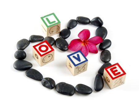 Love decorated by stones with fragipani flower and wooden block letters   photo