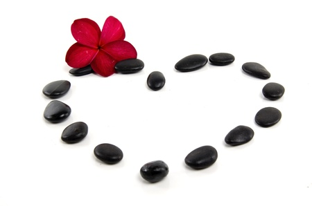 red pebble: Spa concept with zen stones and fragipani flower in love design
