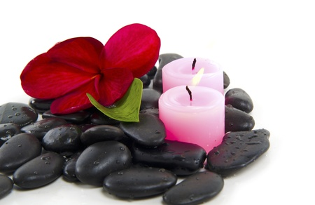 Spa concept with zen stones, candle and fragipani flower  photo