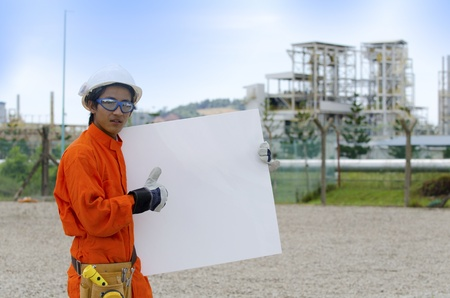 Oil and gas worker with blank board  photo