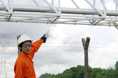 structural steel: Engineer pointing to structural steel pipeline