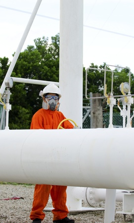 Technician of oil and gas worker is being open up the valve  photo