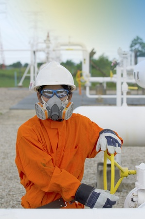 Technician of oil and gas worker is being open up the valve Stock Photo - 12856355