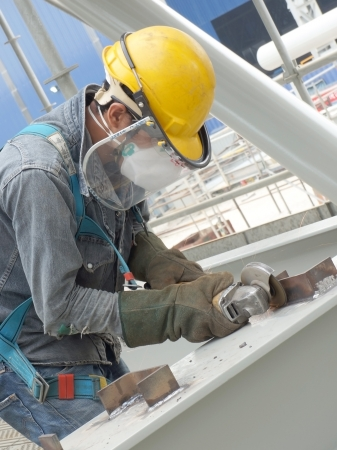 structural steel: Grinding man being work for structural steel framework  Editorial