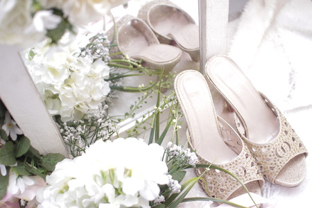 The female shoe arrangement with a flower and mirror box purpose for wedding box. Stock Photo