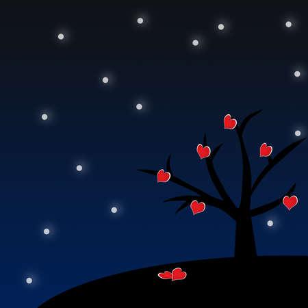 piros szív alakot fa a téli éjszakában.