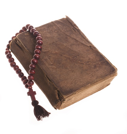 Old bible and wooden rosary photo