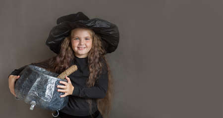 girl in halloween witch costume brew a portion