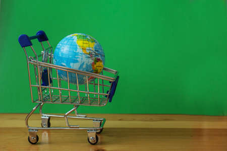 Little earth planet in shopping cart. Sale concept.